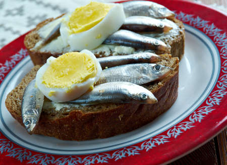 estonian: Kiluvoileib - Estonian sandwich with butter and anchovies.