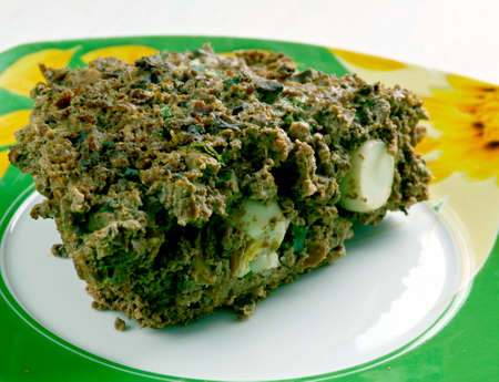 offal: Drob  -  traditional Romanian dish, similar to a haggis, made of minced lambs offal wrapped in caul and roasted like a meatloaf