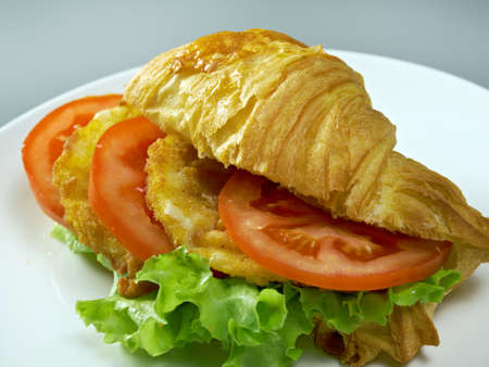 chicken nuggets: Summer Morning Breakfast Croissant stuffed chicken nuggets Stock Photo
