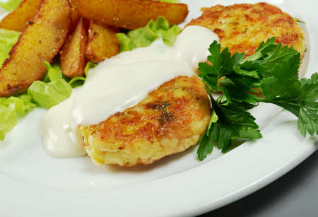 cutlets: Chicken cutlets with roasted potatoes Stock Photo