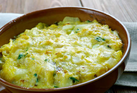 bacalao: Tortilla de Bacalao.Spanish tortilla with vegetables and cod.