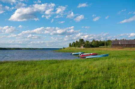 motor boat: Lake Kenozero . Motor boat on the shore. Arkhangelsk region, Russia