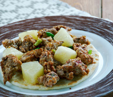 developed: tacos al pastor  with pineapple-  dish developed in Central Mexico Stock Photo