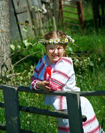 slavic: little Slavic  girl in national dress in Russian village