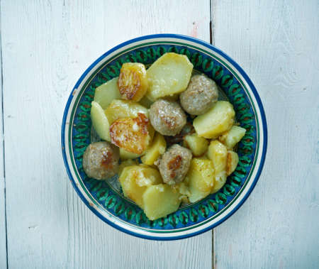 palestinian: Kafta and Potatoes with Tahini Sauce - Mediterranean Meatballs .Palestinian style Kafta dish Stock Photo