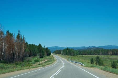 buryatia: Motorway in Buryatia. road leading to the Mountains Stock Photo