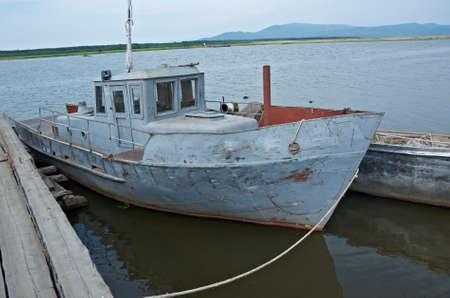 wharf: mooring and wharf fishing  boat at Baikal