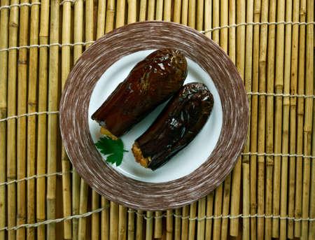 Taze Patl?can Dolmas? Tarifi .Turkish cuisine Eggplants  stuffed with meat and rice Stok Fotoğraf - 62077292