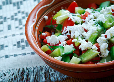 serbian: Serbian Salad -  vegetable salad made from diced fresh tomatoes, cucumber,feta and onions