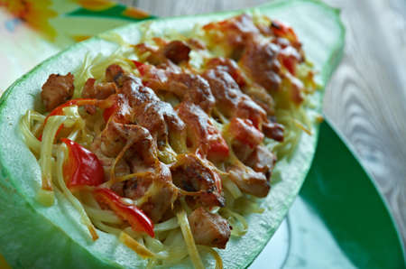 ooking: Pesto Chicken Stuffed Spaghetti Squash.Italian Cuisine Stock Photo