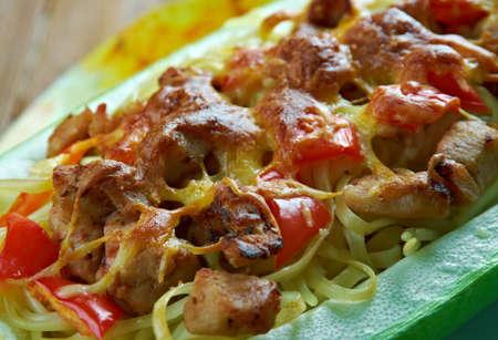 Pesto Chicken Stuffed Spaghetti Squash.Italian Cuisine Stock Photo