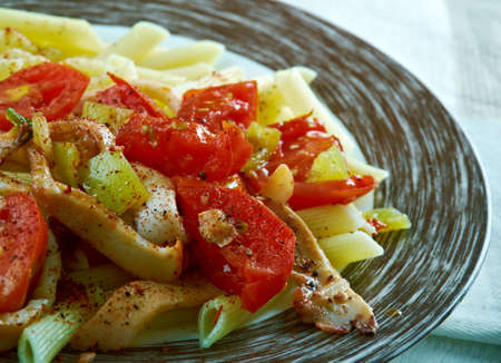 Penne with squid, Baked Peppers and Pangrattato
