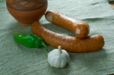 Krakowska Polish sausage kielbasa. made from cuts of lean pork, seasoned with pepper, allspice, coriander, and garlic, Stock Photo
