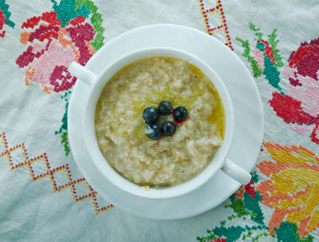 kasha: puuro -Finnish version  Porridge dish made by boiling ground, crushed, or chopped starchy plants . Stock Photo