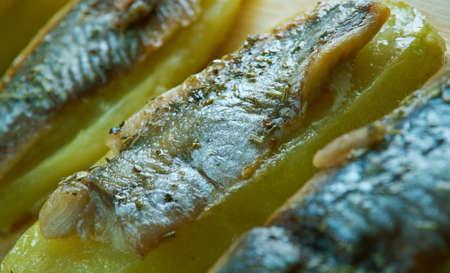con: Patata con anguila al horno - Eel with baked potatoes.Spanish cuisine