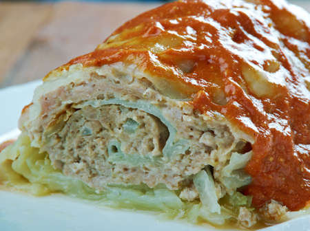 roll out: Roll out a leaves of cabbage and minced meat. Cabbage roll,Belarusian cuisine Stock Photo