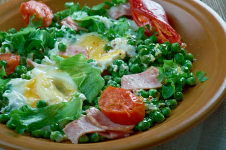 Ervilhas com ovos Stewed peas with poached eggs.Portuguese cuisine