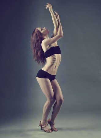modern style dancer posing on  gray background