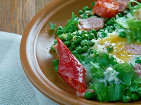 poached: Ervilhas com ovos Stewed peas with poached eggs.Portuguese cuisine