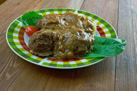 offal: Welsh Faggots ,Welsh-Style Pork Meatballs in a buttery caramelized onion gravy. Stock Photo