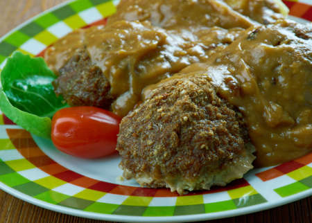 Welsh Faggots ,Welsh-Style Pork Meatballs in a buttery caramelized onion gravy. Stock Photo