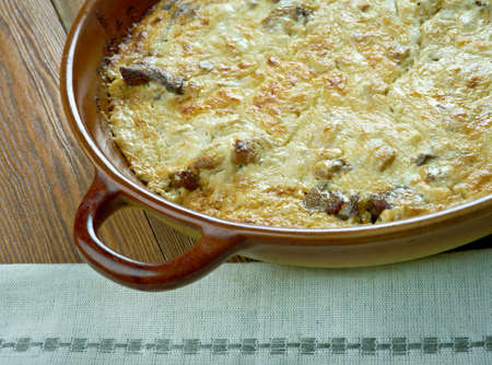 braised mushrooms: veal Orloff dish of Russian cuisine.French-style meat consists of a braised loin of veal, thinly sliced, filled with a thin layer of pureed mushrooms and onions,bechamel sauce