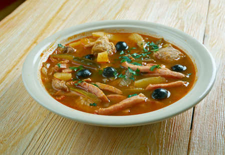 meat  seljanka thick, spicy and sour Russian soup. ingredient  meat, pickled cucumbers ,ham, sausages,  or mushrooms.