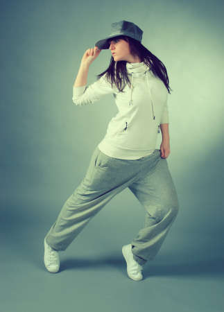 rapping: modern style dancer posing on  gray background
