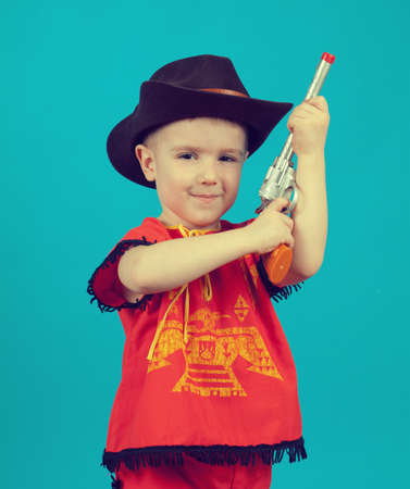 little boy wearing a cowboy hat a over blue background Stock Photo
