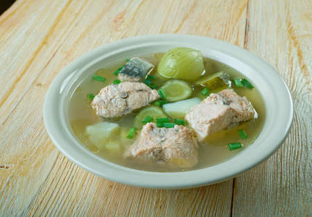 Russian fish solyanka soup with salmon