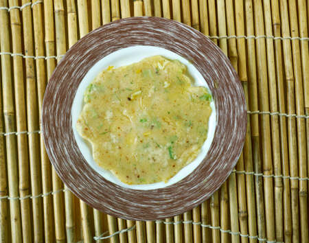 karnataka: Akki rotti -  Spicy Indian  traditional breakfast dish,made from rice flour, carrot and coconut.