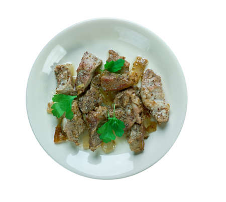 Tantalizing Trini Geera Pork.  pork cooked only with cumin seeds and pepper. Caribbean cuisine Stock Photo