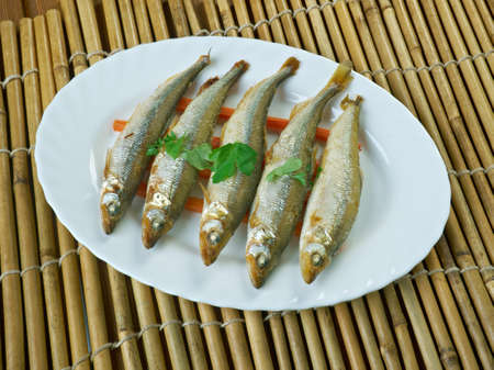 baked smelt served with roasted carrots