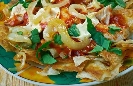 con: Chilaquiles con salsa roja traditional Mexican dish.