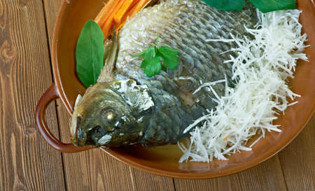 poached: Czech Carp Poached with Paprika Stock Photo