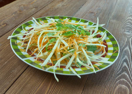 Coleslaw with carrots and lettuces. close up
