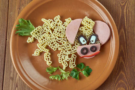 creative food concept  - Goby man made of  Pasta, sausage, vegetables