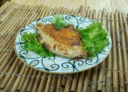 Masgouf -  Mesopotamian dish consisting of seasoned, grilled carp; it is often considered the national dish of Iraq. Stock Photo