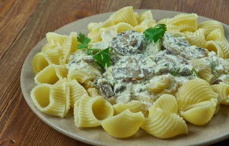 Italian pasta gomiti with mushroom sauce.close iup