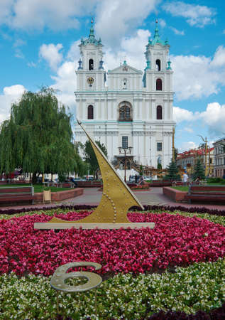 reloj de sol: Sundial on the background  Cathedral Of St Francis Xavier in City Center in Grodno. Belarus