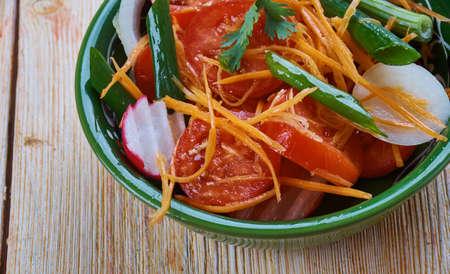 Achichuk Salad.  traditional uzbek salad with tomatoes, onions and greens Stock Photo