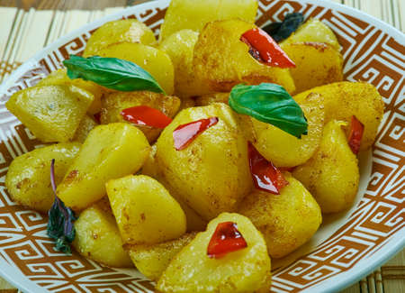 Aloo jerra - Indian dish of sauteed boiled potatoes with cumin and green chillies, close up Stock Photo
