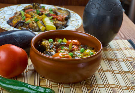 Bulgarian guvec , Dish of stewed vegetables and greens, close up