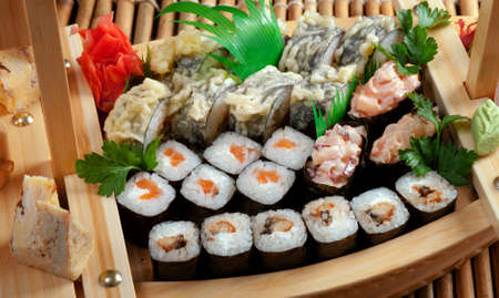 Assorted sushi rolls  - Japanese food on  Sushi Boat  ,traditional japanese food.