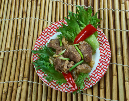 Sha cha beef -  Chinese dish featuring shacha sauce and tenderized beef strips.Chinese-American dishes