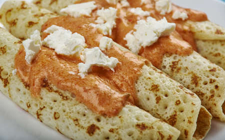 Entomatada  typical Mexican dish made of a folded corn tortilla which has first been fried in oil and then bathed in a tomato sauce made from tomatoes, garlic, onion, oregano, chile serrano