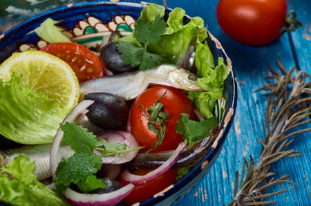 Maghreb cuisine . Algerian Salad with Anchovies close up Stock Photo