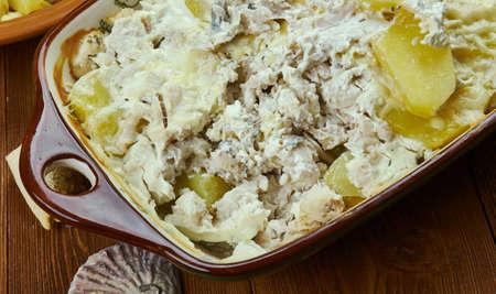 Portuguese cuisine - Bacalhau com natas, Traditional Portugal dishes, Top view. Banco de Imagens