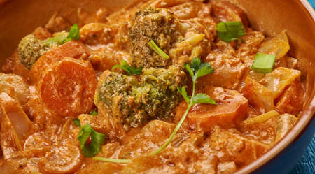 East African cuisine - Ethiopian Inspired Berbere Chicken Curry, Traditional assorted African  dishes, Top view.