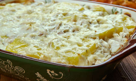Portuguese cuisine - Bacalhau com natas, Traditional Portugal dishes, Top view. Imagens